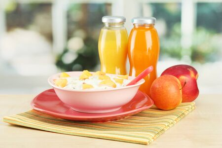 tasty dieting food and bottles of juice, on wooden table Stock Photo - 16566441