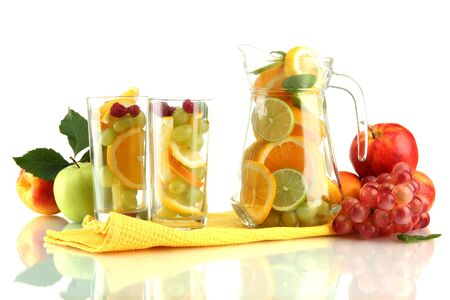 transparent jar and glasses with citrus fruits, isolated on white photo