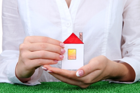 concept: woman hands with paper house, close up Stock Photo - 16586854