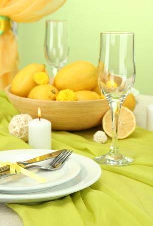 beautiful holiday table setting with lemons, close up photo