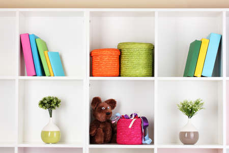 Color wicker boxes on cabinet shelves Stock Photo - 16588941