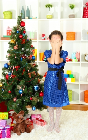 Little girl waiting her christmas gifts photo