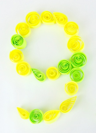 quilling: The digit 9 is made of quilling isolated on white