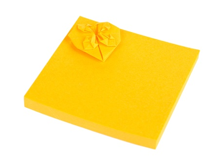 Orange sticky notes isolated on white photo