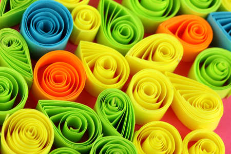 quilling: Colorful quilling on pink background close-up