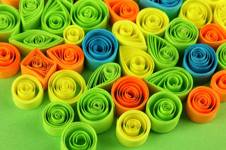 quilling: Colorful quilling on green background close-up Stock Photo