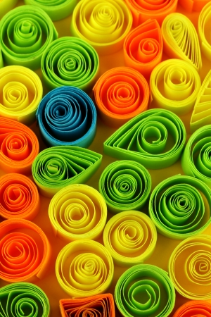 quilling: Colorful quilling on yellow background close-up