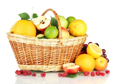 Assortment of exotic fruits in basket, isolated on white photo