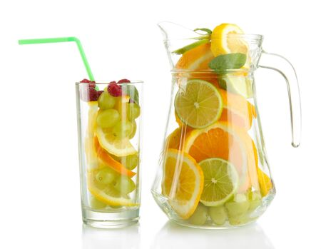 transparent jar and glass with citrus fruits and raspberries, isolated on white Stock Photo - 16590745