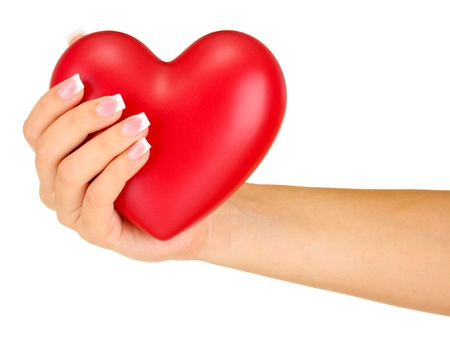beloved: Red heart in womans hand, on white background close-up Stock Photo