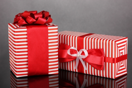 Colorful red gifts on grey background photo