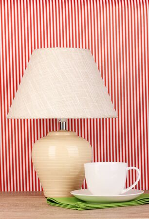 table lamp and cup on striped background Stock Photo - 16590807