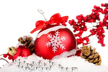 beautiful bright Christmas balls on snow, isolated on white photo