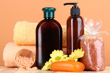 Set for care of a body on peach background Stock Photo - 16591465