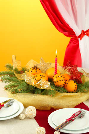 beautiful christmas table setting with tangerines and fir tree, close up Stock Photo - 16591616