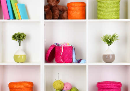 Color wicker boxes on cabinet shelves Stock Photo - 16591636