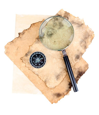 Old paper wiht magnifying glass and compass isolated on white photo