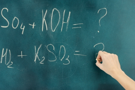 Chemical formula written on blackboard with chalk. photo