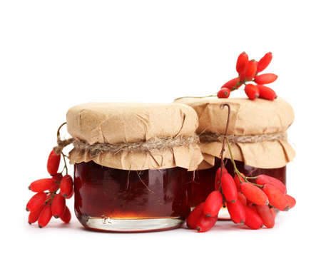 ripe barberries and jars of jam isolated white Stock Photo - 16603388