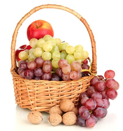 Grape in basket with nuts isolated on white photo