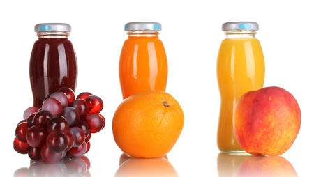Delicious grapes, orange and apple juice in glass bottle and fruit next to it isolated on white Stock Photo - 16620127