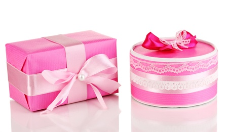 Colorful pink gifts isolated on white photo