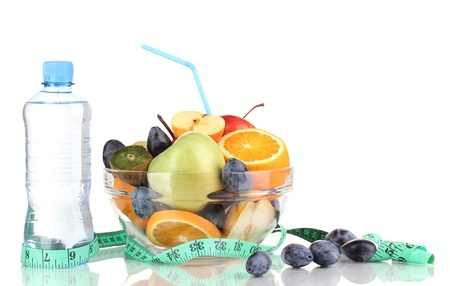 Glass bowl with fruit for diet, measuring tape and water bottle isolated on white Stock Photo - 16620133