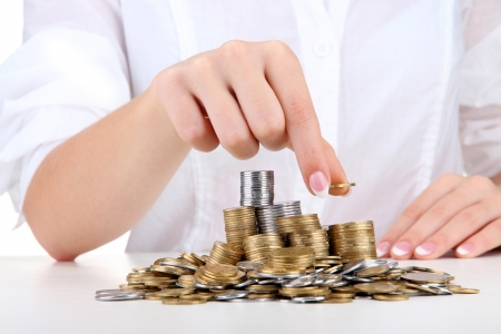 Woman hands with coins, close up Stock Photo - 16620446