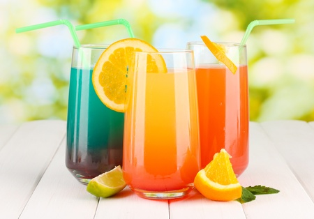Three cocktails on wooden table on bright background Stock Photo - 16620284
