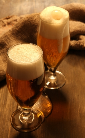 Glasses of beer on wooden table close-up Stock Photo - 16620453