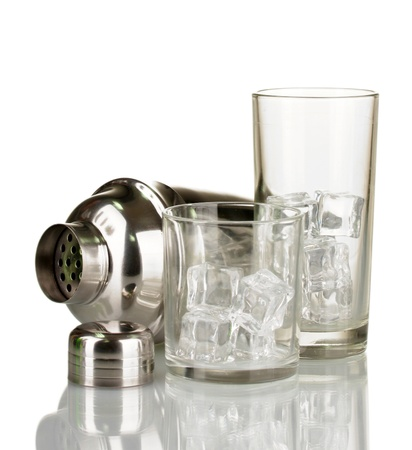 Cocktail shaker and glasses isolated on white photo