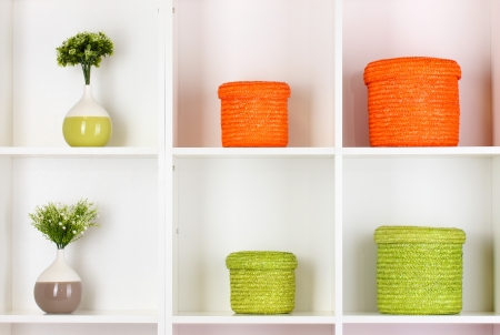 Color wicker boxes on cabinet shelves Stock Photo - 16620383