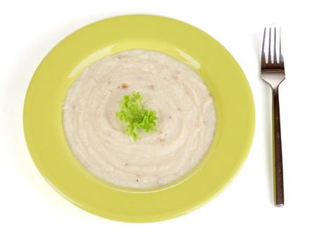 nutritiously: Mashed potatoes in green plate isolated on white