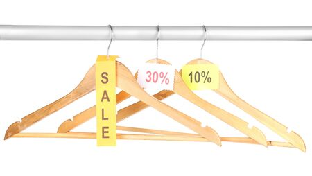 wooden clothes hangers as sale symbol isolated on white Stock Photo - 16667443