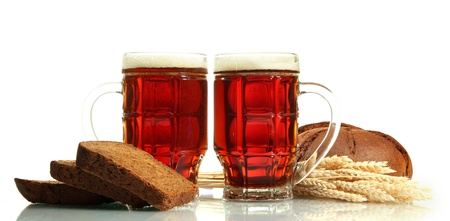 tankards of kvass and rye breads with ears, isolated on white photo
