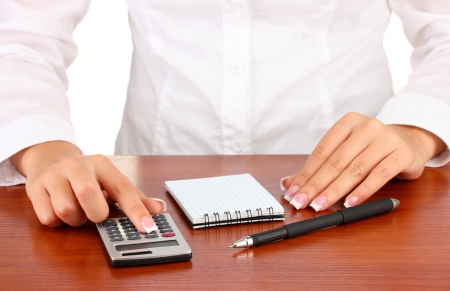 Woman's hands counts on the calculator, close-up Stock Photo - 16669805
