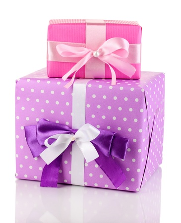 Colorful pink and purple gifts isolated on white photo