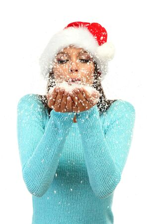 beautiful young woman blowing snow, isolated on white photo