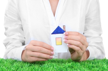 concept: woman hands with paper house, close up Stock Photo - 16669572