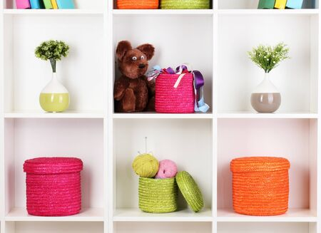 Color wicker boxes on cabinet shelves Stock Photo - 16670196