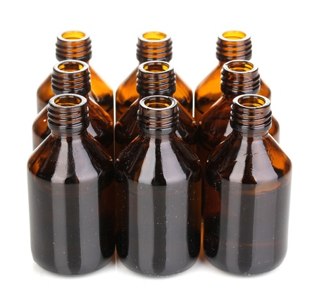 Medical bottles in the row isolated on white photo