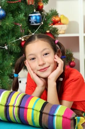Little girl dreaming near christmas tree Stock Photo - 17129888