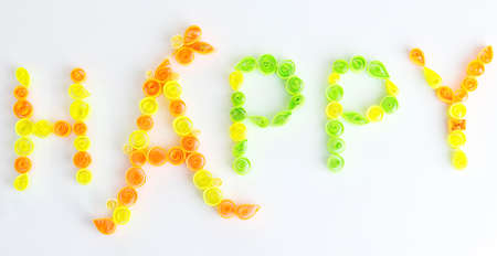 quilling: The word happy is made of quilling isolated on white Stock Photo
