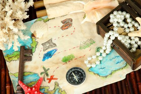 map of treasures on dark wooden background Stock Photo - 16732735