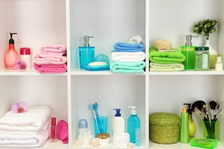 Bath accessories on shelfs in bathroom Stock Photo