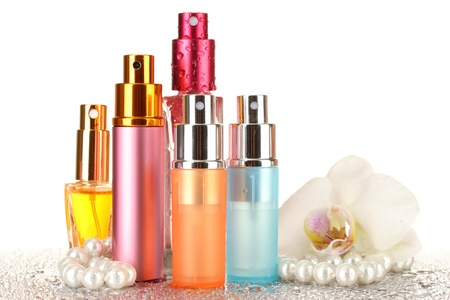 womens perfume in beautiful bottles and orchid flower, isolated on white photo