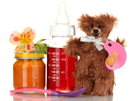Baby bottle with fresh juice, puree and teddy bear isolated on white Stock Photo - 16669546