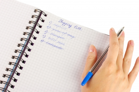 woman's hand holding a notebook with a shopping list close-up Stock Photo - 16728204
