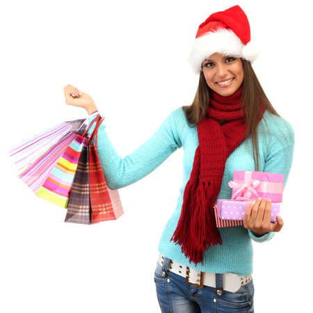 beautiful young woman with shopping bags and gifts, isolated on white photo