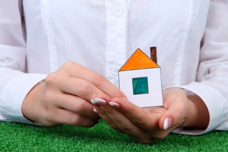 concept: woman hands with paper house, close up Stock Photo - 16728156